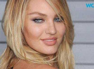 News video: Candice Swanepoel Gets Tanned and Topless for Maxim